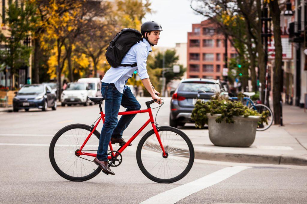 An image of a man riding a Schwinn Stites cheap fixie down the road