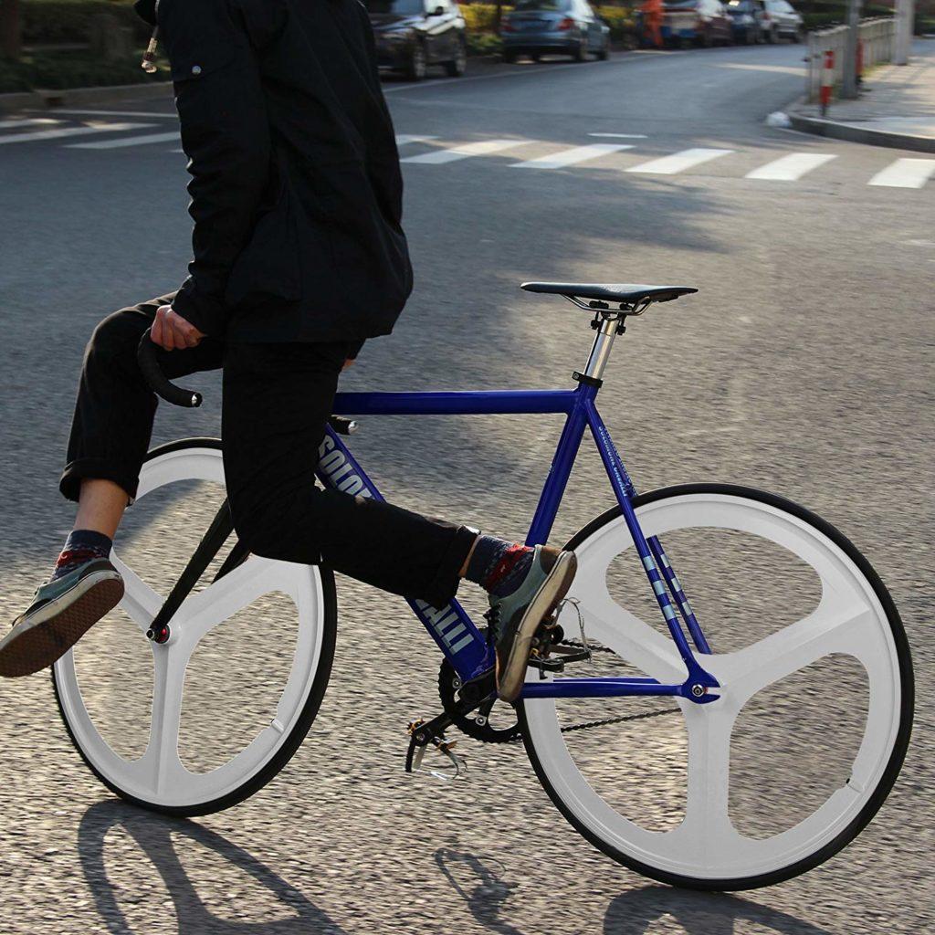 A fixie rider skidding on a bike with Solomone tri spoke fixie wheels