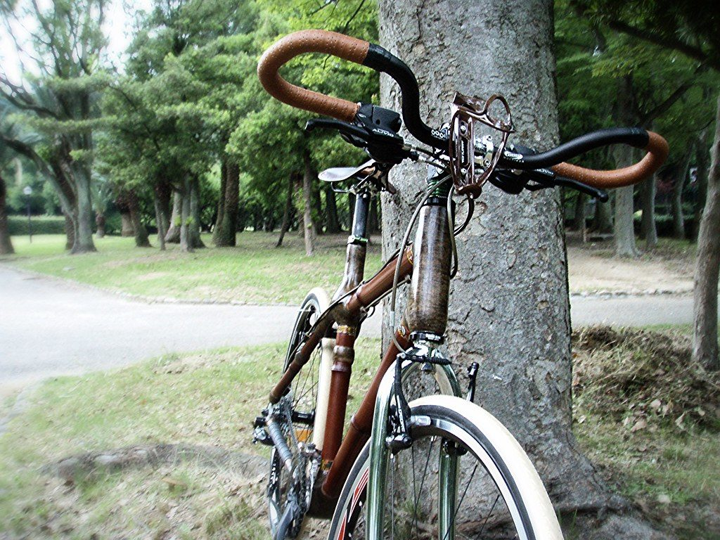 A bike leaning against a tree meant to show the butterfly fixie handlebars