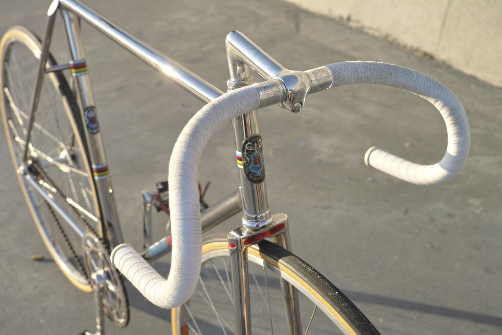 A white fixie fitted with the best fixie track drop handlebars