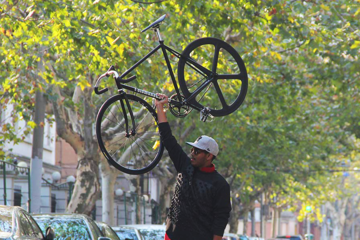An image of a man holding up a bike with the Solomone Cavalli Fixie Wheels intended to show off the wheel for a Solomone Cavalli Fixie Wheels Review
