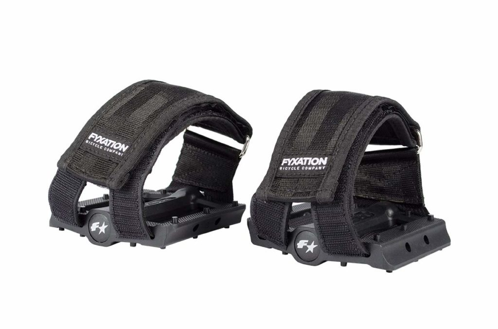 An image of the fyxation fixe pedals and straps in black, intended to show off the product for a Fyxation Pedals & Straps Review