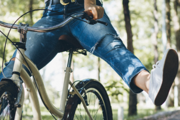 An image of a girl riding a bike to be used as the featured image for a list of the best fixie saddles in 2019