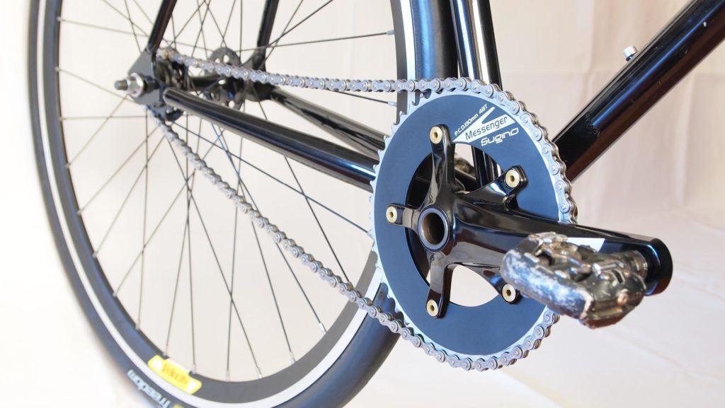 An image of the SRAM Courier Crankset on a bike, intended to show off the product for a review of the best fixie cranksets.